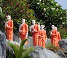 Orange robas in Dambulla